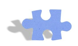 Puzzle piece with shadow on white Stock Images