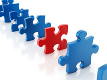 Puzzle piece stands out Stock Photos