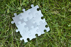 Puzzle piece team working well together Stock Photos