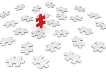 Puzzle piece wins other ones. Many 3d puzzle pieces are lying on the ground but one of different color is standing up Royalty Free Stock Photography
