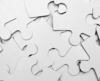 Puzzle pieces. Blank puzzle pieces mixed up as background stock photo