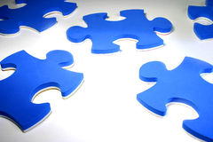Puzzle pieces. Blue and white puzzle pieces Stock Image