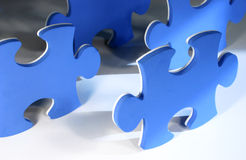 Puzzle pieces. Blue and white puzzle pieces Royalty Free Stock Image