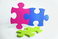 Puzzle pieces. Green, magenta and blue puzzle pieces Royalty Free Stock Photo