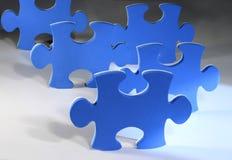 Puzzle pieces. Blue puzzle pieces on white surface Stock Photo