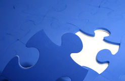 Puzzle pieces. Blue puzzle pieces on white surface Royalty Free Stock Images