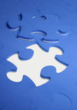 Puzzle pieces. Blue puzzle pieces on white surface stock photo