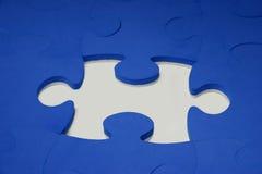 Puzzle pieces. Blue puzzle pieces on white surface Stock Photos