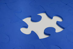 Puzzle pieces. Blue puzzle pieces on white surface Royalty Free Stock Image