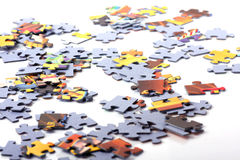 Puzzle pieces. Colored puzzle pieces on a white royalty free stock photos