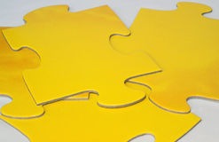 Puzzle pieces. KONICA MINOLTA DIGITAL CAMERA royalty free stock photo