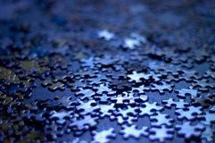 Puzzle pieces. Blue puzzle pieces very shallow depth of field, good background image or concept (confusion, indecision royalty free stock images