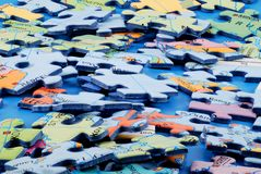 Puzzle pieces. Accumulation of puzzle pieces. close - up but all sharp Stock Images