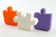 Puzzle pieces. Three colorful puzzle pieces isolated on white stock photos