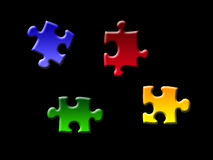Puzzle pieces. Isolated on black royalty free stock photography