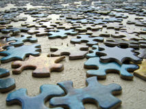 Puzzle Pieces. Laid out on a table Royalty Free Stock Photo