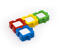 Puzzle Pieces. Puzzle photo frames in L shape, in various colors, and isolated on white background Stock Photos