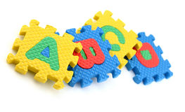 Puzzle pieces of alphabets. Multi colored Alphabet Puzzle Pieces  on White Background Royalty Free Stock Photo
