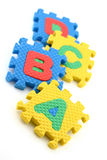 Puzzle pieces of alphabets. Multi colored Alphabet Puzzle Pieces on White Background stock illustration