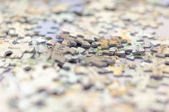 Puzzle pieces background texture. Puzzle pieces background with shallow depth of field and copy space Royalty Free Stock Image