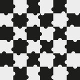 Puzzle pieces. 6 x 6 puzzle pieces in black and light grey Royalty Free Stock Photography