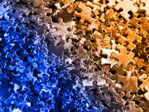 Puzzle pieces: blue-orange. Stack of jigsaw puzzle pieces Stock Photography