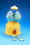 Puzzle Pieces in Bubblegum Machine. On Blue Background Stock Images