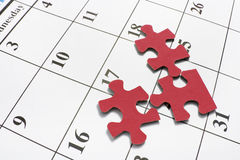 Puzzle Pieces on Calendar Stock Photo