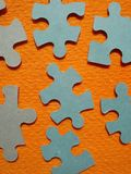 Puzzle pieces. Close view of puzzle parts on orange background Royalty Free Stock Photography
