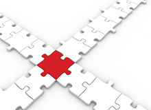 Puzzle pieces connected. Puzzle pieces joined by a single red Royalty Free Stock Image