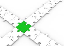 Puzzle pieces connected. Puzzle pieces joined by a single green Stock Photography
