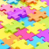 Puzzle pieces covered surface Stock Photo