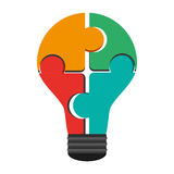 puzzle pieces creating lightbulb icon Stock Photography