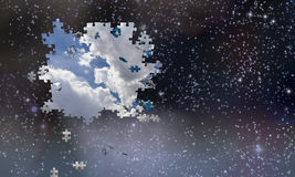 Puzzle pieces fall from night sky Royalty Free Stock Photo