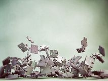Puzzle pieces falling Royalty Free Stock Photo
