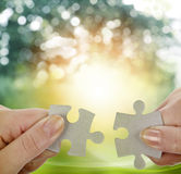 Puzzle pieces. Fingers holding two puzzle pieces royalty free stock image