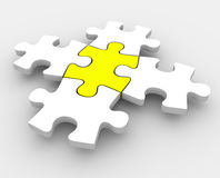Puzzle Pieces Fitting Together One Central Integral Middle Part. Jigsaw puzzle pieces fitting together with one yellow central piece as the middle or center Royalty Free Stock Images