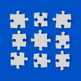 Puzzle pieces in a flat design Royalty Free Stock Images