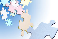 Puzzle pieces floating. Colored puzzle pieces floating over a white background royalty free stock photography