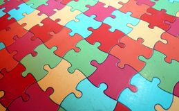 Puzzle pieces that form an intricate mosaic colored Royalty Free Stock Photography