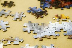 Puzzle Pieces Game on a Table. Board Games at Home.