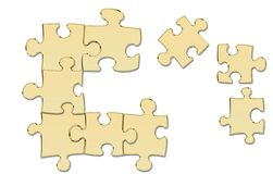 Puzzle pieces of gold Stock Images