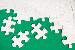 Puzzle. Pieces on green background close up Royalty Free Stock Image
