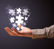 Puzzle pieces in the hand of a businessman Royalty Free Stock Images