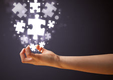 Puzzle pieces in the hand of a woman Stock Photo