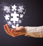 Puzzle pieces in the hand of a woman Royalty Free Stock Images
