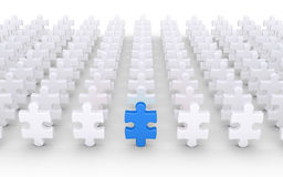 Puzzle pieces and leader. Many puzzle pieces in rows and one different is in front Royalty Free Stock Photo