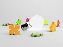 Puzzle pieces and light bulb Stock Images