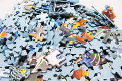 Puzzle pieces. Many puzzle pieces stock photo