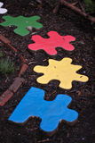 Puzzle Pieces Meadowlark Botanical Gardens. Colorful pathway of puzzle pieces lead to endless possibilities open to children who enter the play garden at Stock Photos